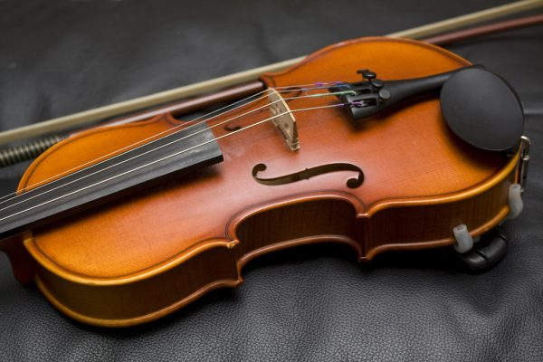 Close up photograph showing the detail of a violin.