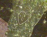 Outline of a heart shape marked on the hillside.