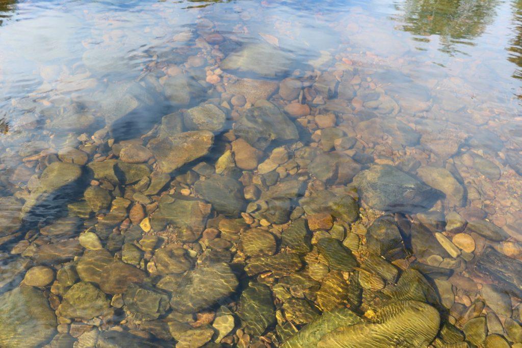 Whiteadder river bed of coloured cobbles.